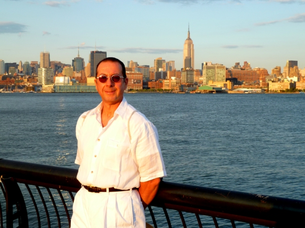 Me, Phil, your guide with the New York City skyline behind me, as seen from Hoboken, NJ, on a late summer day at sunset.