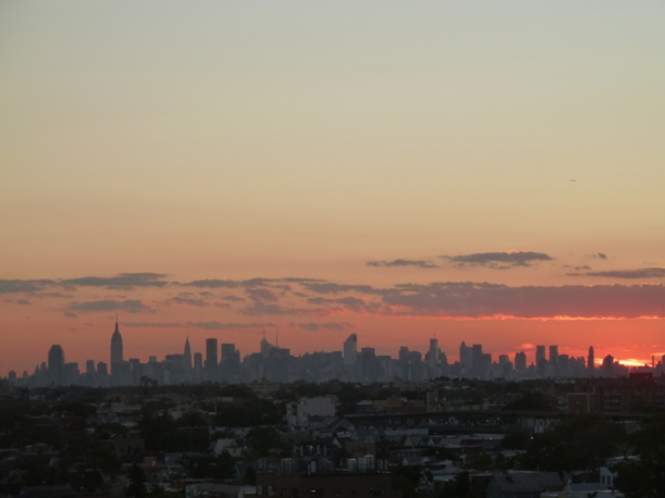 The New York City skyline at sunset, seen from U.S. Tennis Center in Flushing, Queens.