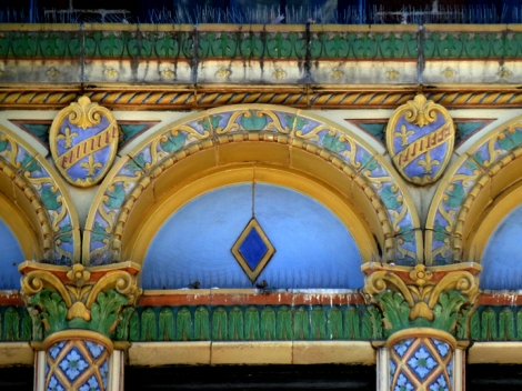 Window arch and mock-heraldic coat of arms at 37 Washington Square West.