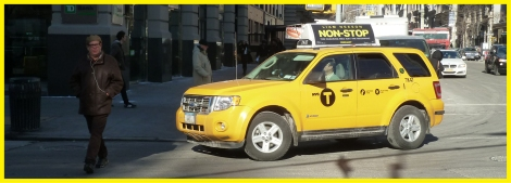 Taxi cabs turning onto New York's Fifth Avenue at 14th Street.
