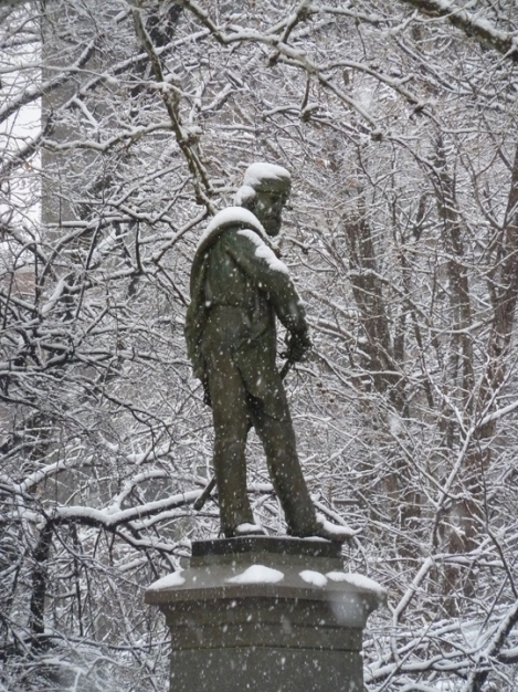 A snowy Giuseppe Garibaldi reaches for his sword in Washington Square Park.