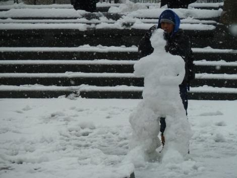 Building a snowman in Washington Square Park's fountain.