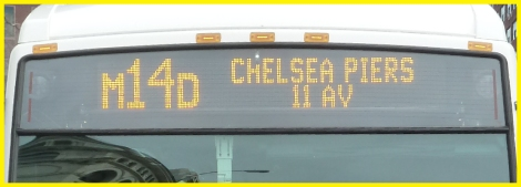 The NYC bus route displayed above the bus's windshield.