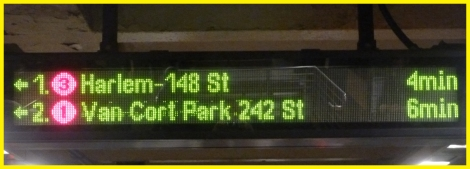 Sign alerting passengers of train status on a NYC Subway Platform.