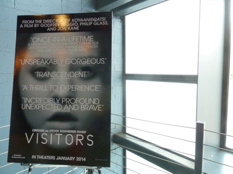 "Poster for the film ""Visitors"" on the main staircase landing at the Landmark Sunshine Theater."